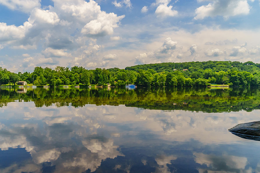 Langhorne PA - View of Blue River with Cloud Reflections and Forest in Langhorne Pennsylvania