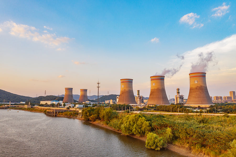 Public Utility Insurance - View of Modern Power Plant Against Blue Sky