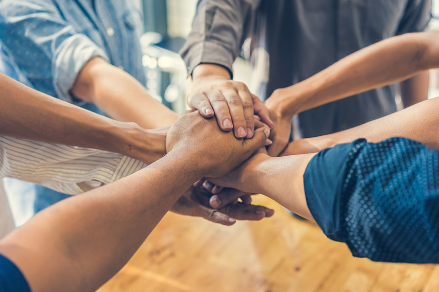 Insurance Partners - Group of Business People Stacking Their Hands Together in the Office